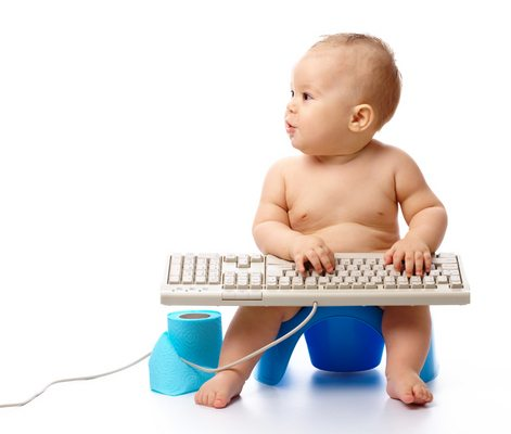 Little child is typing on keyboard