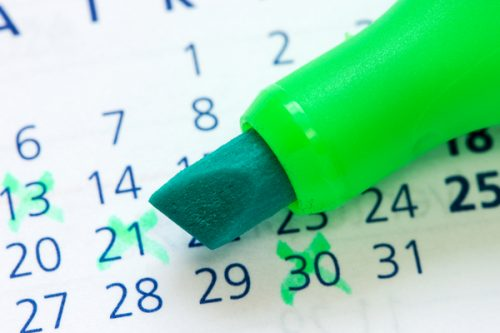 Calendar and green marker
