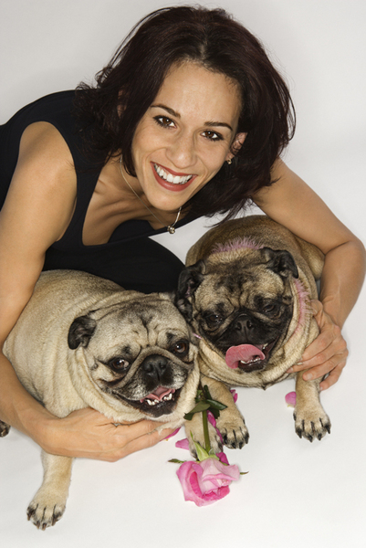 Woman with two Pug dogs.