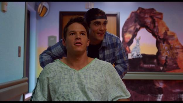23B_sc068_Hapka_Hoover_Jerry pushes Travis in hospital_300dpi