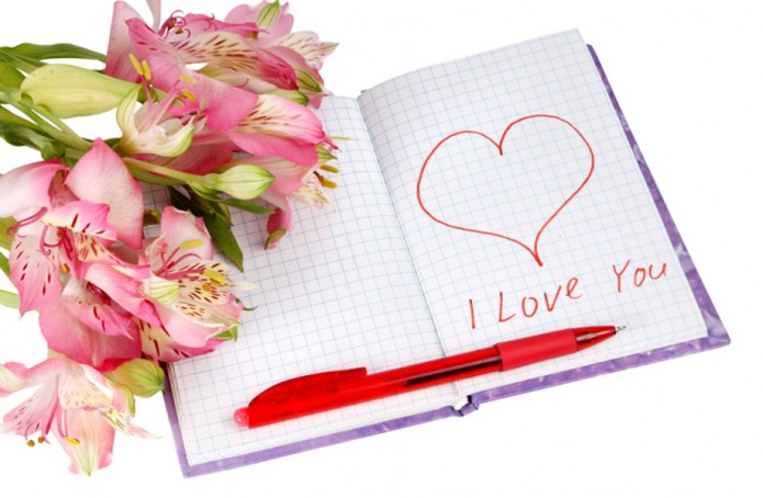 notebook with flowers by a heart and inscription