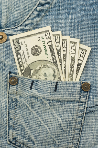 Money in the jeans pocket - 50 dollars banknotes