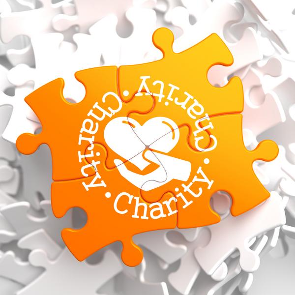 Charity Concept on Orange Puzzle.