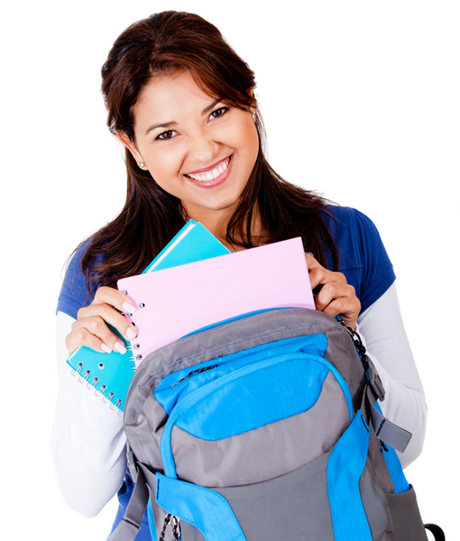 Happy female student taking out books from her bag - isolated